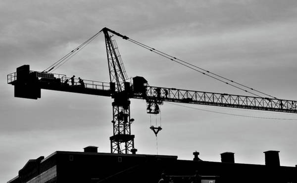 Photograph - Crane And Men Skyline by Jeremy Hall
