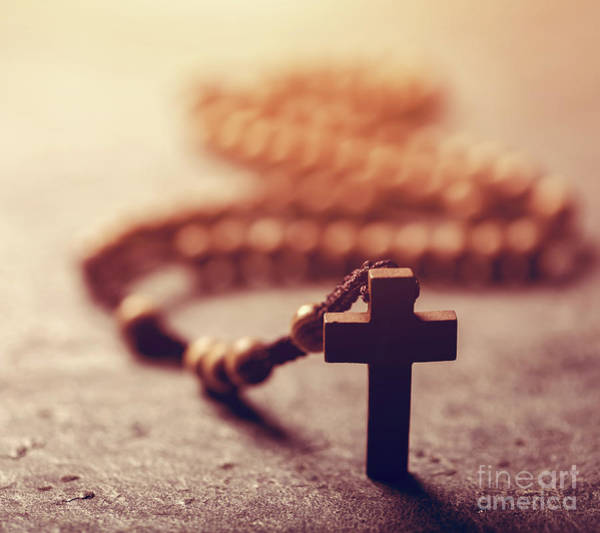 Photograph - Cross And Wooden Rosary On Stone Background. by Michal Bednarek