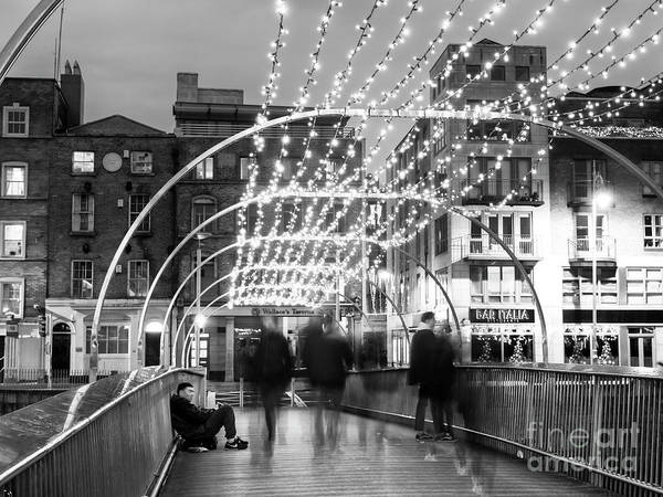 Wall Art - Photograph - Crossing The Millennium Bridge At Night Dublin by John Rizzuto