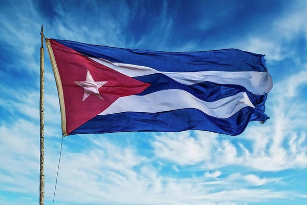 Wall Art - Photograph - Cuba, Havana Vieja, Cuban Flag Waving by Miva Stock