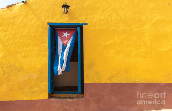 Revolution Wall Art - Photograph - Cuban Flag Hanging On A Door In by Sabino Parente