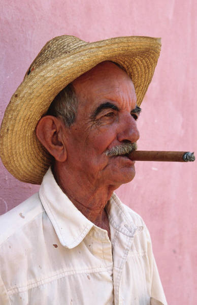 Gray Hair Photograph - Cuban Man Smoking A Cigar Next To Pink by Tim Hughes
