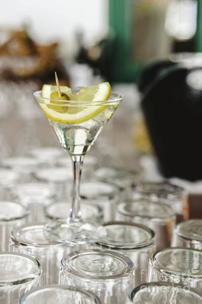 Photograph - Cup Of Gin And Tonic, With A Slice Of Lemon And Olive. by Joaquin Corbalan