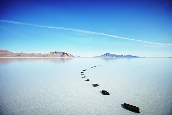 Wall Art - Photograph - Curved Path Of Stones In Calm Lake by Thomas Barwick