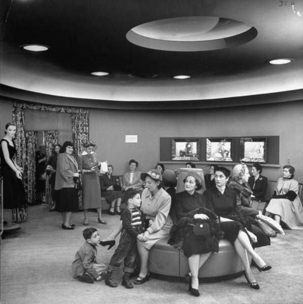 Merchandise Photograph - Cutomers Waiting Patiently For A Clerk by Nina Leen