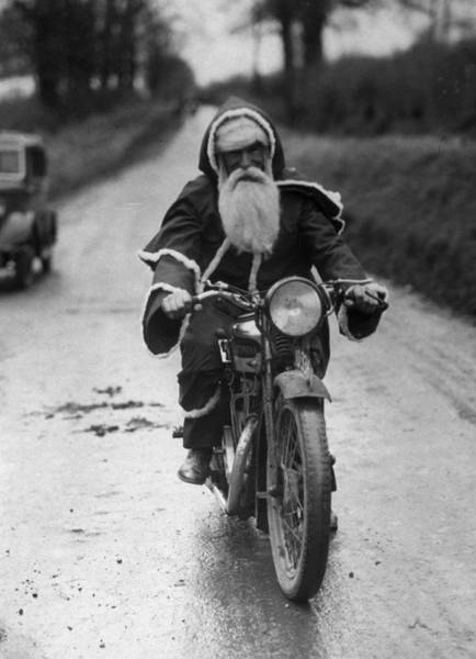 Wall Art - Photograph - Cycling Santa by Fox Photos