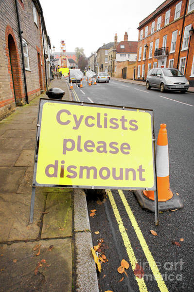 Wall Art - Photograph - Cyclist Dismount Sign by Tom Gowanlock