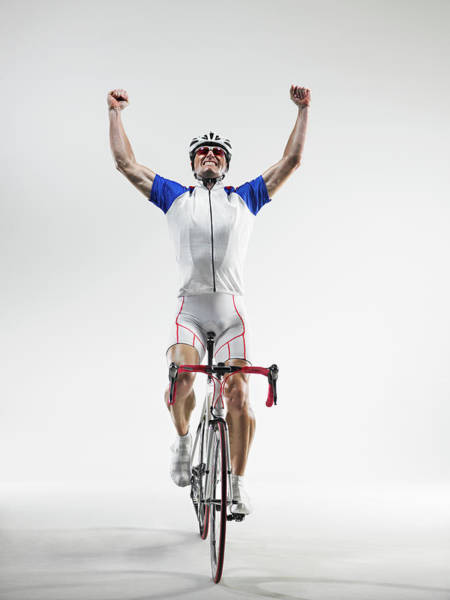 Helmet Photograph - Cyclist Pumping Fists, Studio Shot by Ryan Mcvay