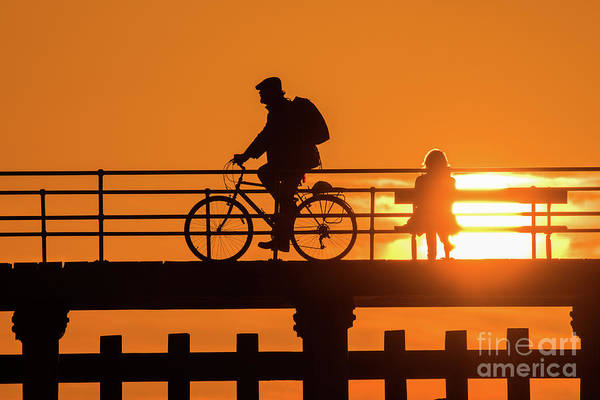 Photograph - Cyclist Silhouetted At Sunset by Keith Morris