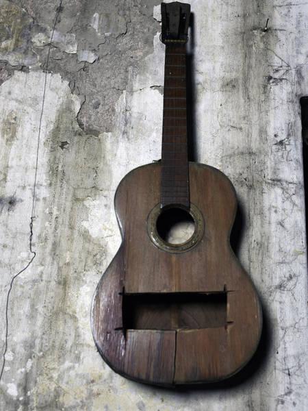 Wall Art - Photograph - Damaged Guitar On A Wall by Win-initiative/neleman