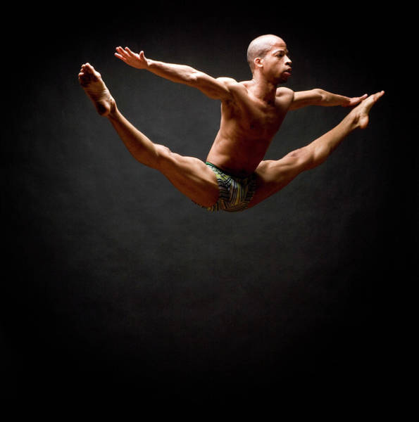 Shirtless Photograph - Dancer Leaping In Air by David Sacks