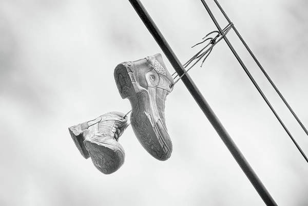 Photograph - Dangling Boots by Cate Franklyn