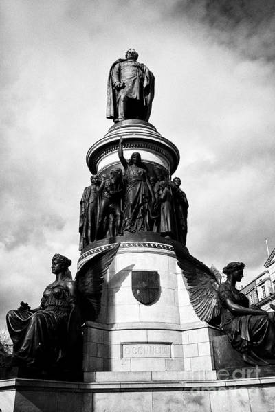 Wall Art - Photograph - daniel oconnell statue on oconnell street Dublin Republic of Ireland europe oconnell on top of figur by Joe Fox