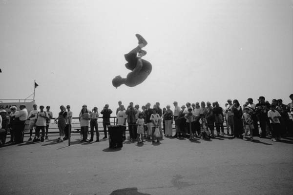 Battery Park Wall Art - Photograph - Danny Salas Does A Backflip During by New York Daily News Archive