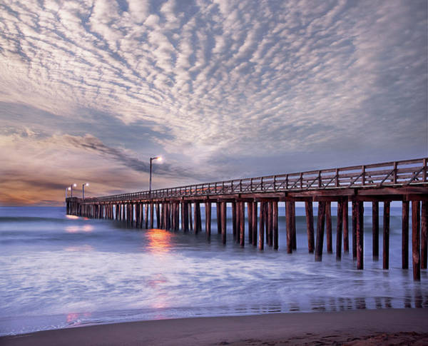 Pacific Ocean Photograph - Dawn Clouds Over Pier In Pacific Ocean by Alice Cahill