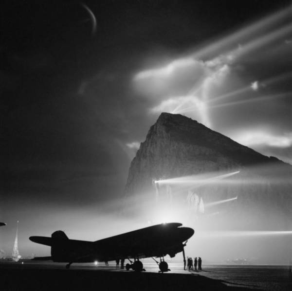Wall Art - Photograph - Airliner Silhouetted By Searchlights - Rock Of Gibraltar - Ww2 by War Is Hell Store
