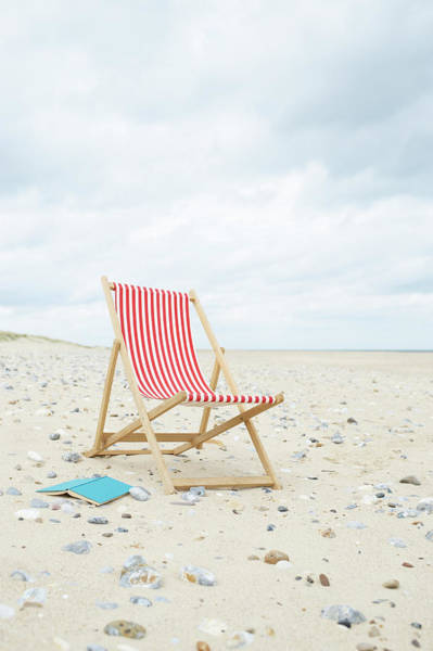 Deck Chair Photograph - Deck Chair With Book On Sand At Beach by Dougal Waters