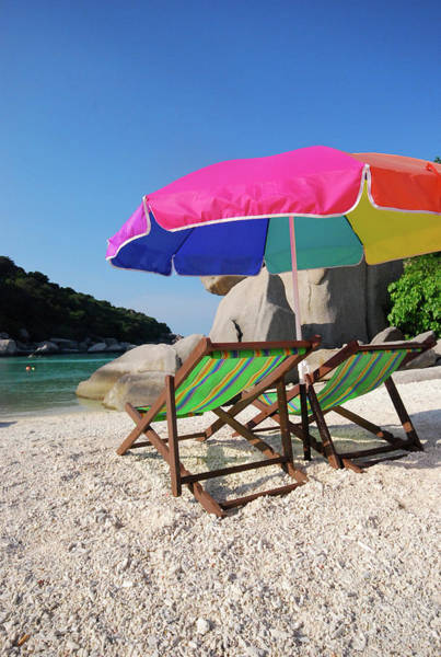 Deck Chair Photograph - Deck Chairs On A Beach In Thailand by Thepurpledoor