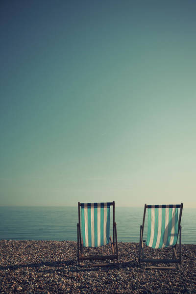 Deck Chair Photograph - Deck Chairs On Brighton Beach by Paul Grand Image