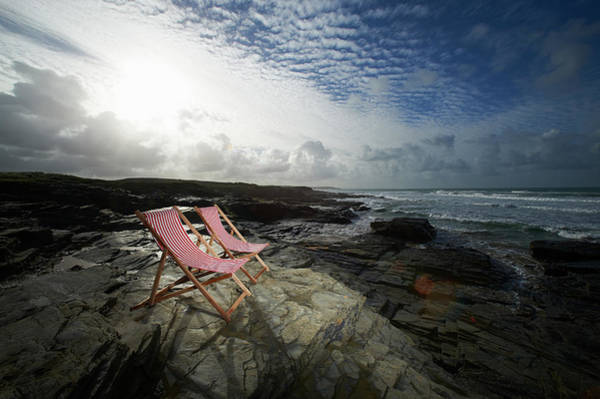Deck Chair Photograph - Deck Chairs On Rocky Coastline by Dougal Waters