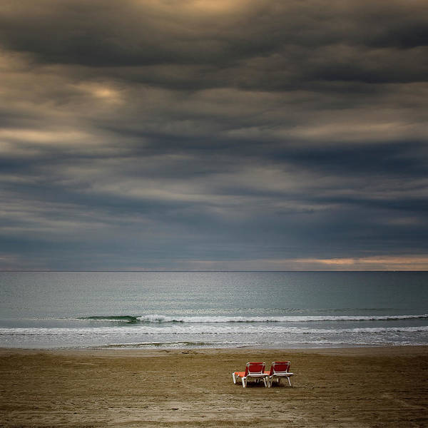 Side-by-side Photograph - Deckchairs In Lonely Beach On Storm Day by Iñaki De Luis