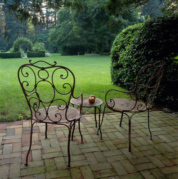 Patio Photograph - Decorative Chair Amd Table On Patio by Richard Felber