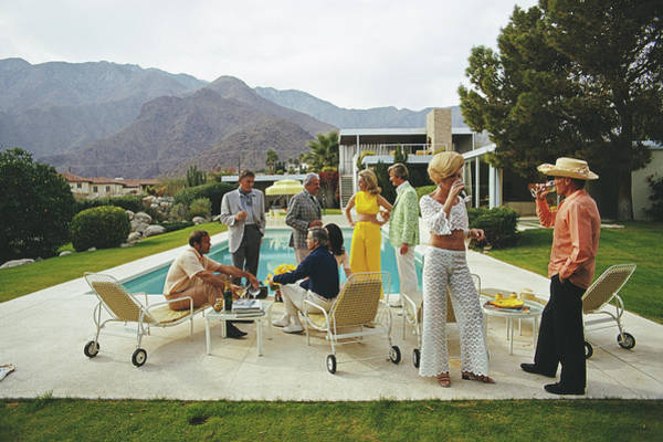 Swimming Pool Photograph - Desert House Party by Slim Aarons