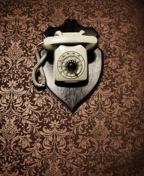 Rotary Photograph - Desk Telephone Hanging As A Trophy On A by Henrik Sorensen