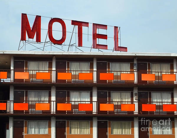 Wall Art - Photograph - Detail Of A An Old Motel Sign Atop An by Duckeesue