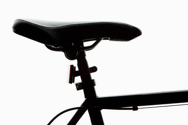 Bicycle Photograph - Detail Of A Bicycle Seat, Back Lit by Epoxydude