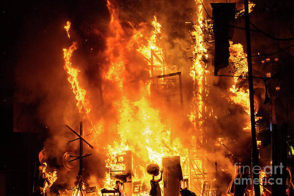 Photograph - Detail Of A Falla Valenciana Burning Between Flames Of Fire. by Joaquin Corbalan
