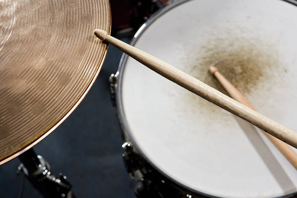 Photograph - Detail Of Drumsticks And A Drum Kit by Antenna