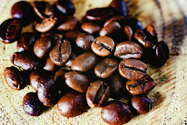 Photograph - Detail Of Roasted Coffee Beans, Produced In Colombia. by Joaquin Corbalan