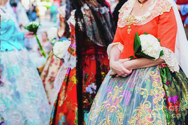 Photograph - Detail Of The Traditional Spanish Valencian Fallera Dress, Colorful Fabrics With Intricate Embroidery. by Joaquin Corbalan