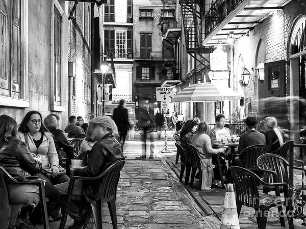 Photograph - Dinner In Pirates Alley At Night New Orleans by John Rizzuto