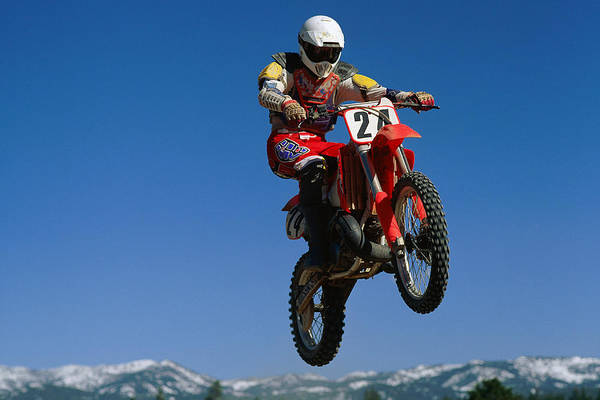 Motocross Photograph - Dirt Biker In Mid-air by Stockbyte