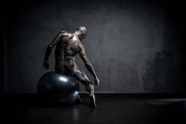 Naked Photograph - Dirty Naked Man Sitting On Gym Ball by Paolomartinezphotography