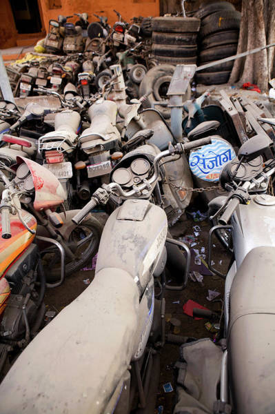 Dust Photograph - Discarded Motor Cycles In The Street In by Cormac Mccreesh