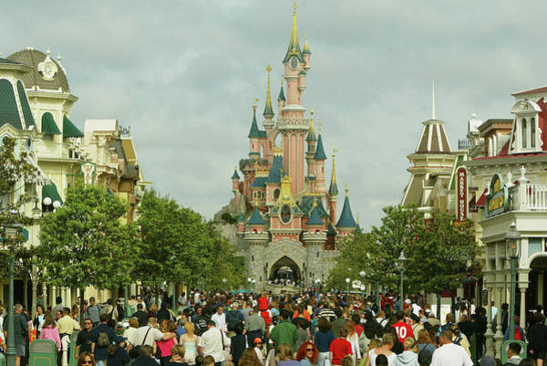 Mickey Mouse Photograph - Disneyland Paris Becomes One Of Europes by Pascal Le Segretain