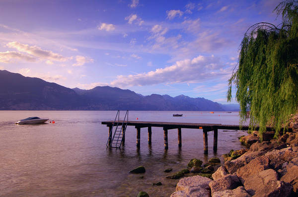 Bleached Photograph - Dock And Boat On Lake, Lago Di Garda by Radius Images