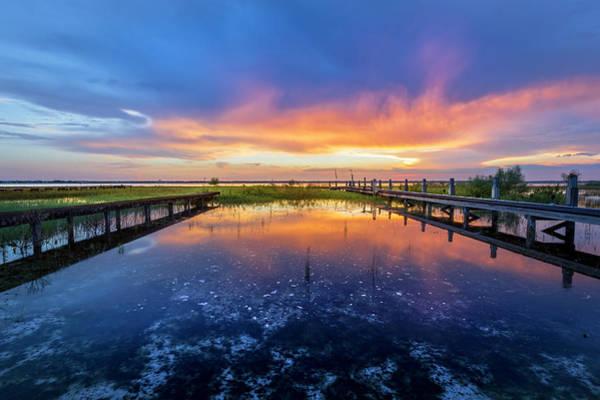 Photograph - Docks Under Evening Fire by Debra and Dave Vanderlaan