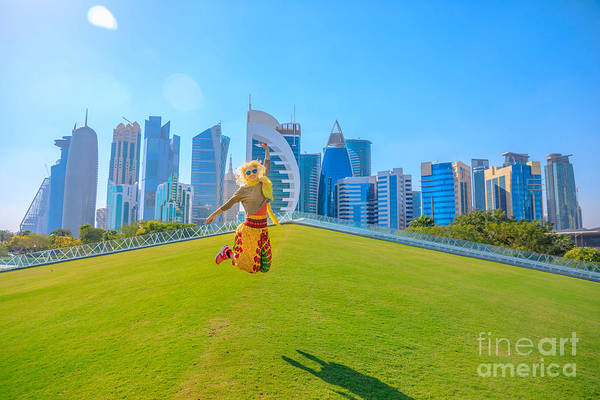 Photograph - Doha Skyline Woman Jumping by Benny Marty