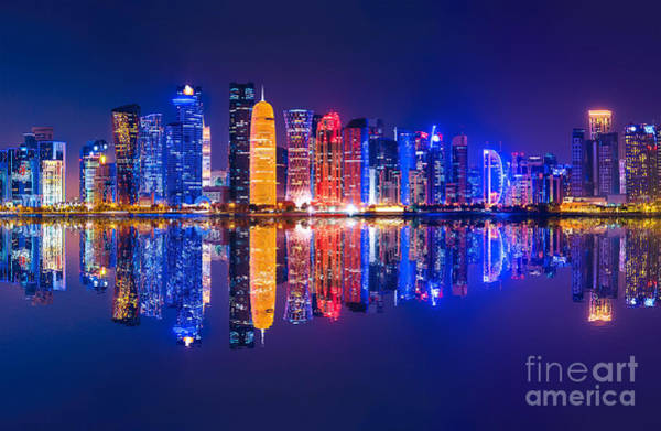 Photograph - Doha Skyscrapers Reflecting Night by Benny Marty