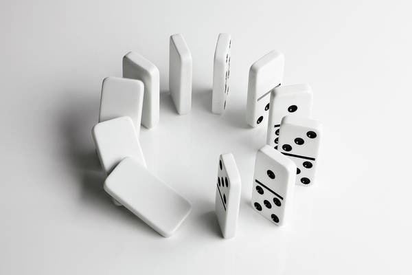 Luck Photograph - Dominoes In A Circle Beginning To Fall by Larry Washburn