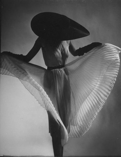 Fashion Model Photograph - Dorian Leigh Models A Hat by Gjon Mili