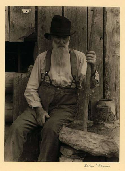 Wall Art - Painting - Doris Ulmann   1882-1934 , Elderly, Bearded Man In Hat And Suspenders, Seated With Big Stick by Celestial Images