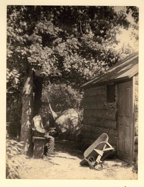 Wall Art - Painting - Doris Ulmann   1882-1934 , Elderly Man With Hat And Pipe, Sitting On Bench Beside Log Cabin And Over by Doris Ulmann