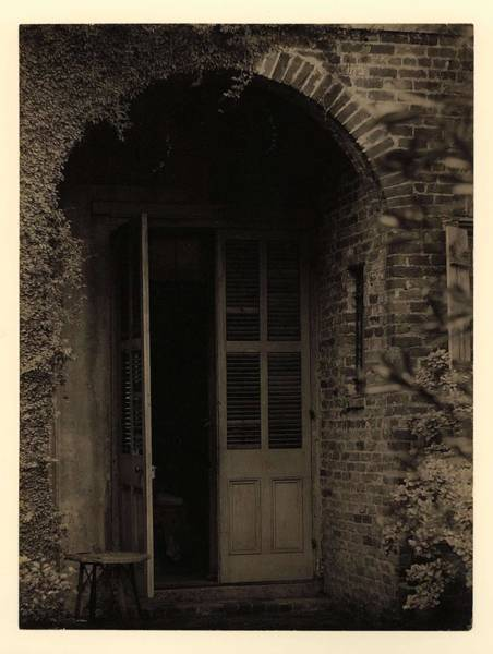 Wall Art - Painting - Doris Ulmann  1882-1934, Arched Brick Doorway With Partially Open Door And Vines Growing On Wall by Doris Ulmann