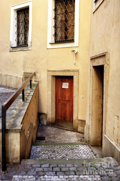 Photograph - Down The Stairs In Prague by John Rizzuto