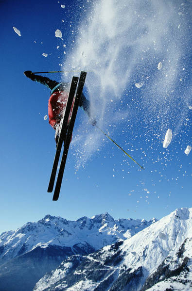 Alpine Skiing Photograph - Downhill Skier In Mid-air, Rear View by Ross Woodhall